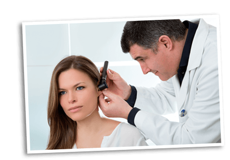 Doctor examining a patients ear