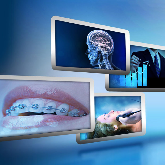 Futuristic collage of screens with dental photos on them over a blue background