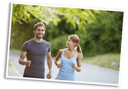 Young happy couple jogging