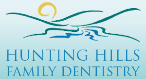 Hunting Hills Family Dentistry Logo - Blue serif type with mountain icon on top