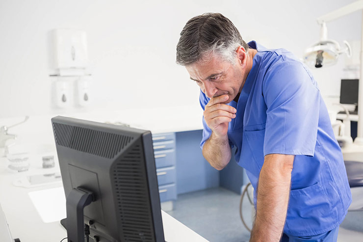 Doctor Looking At Computer Monitor