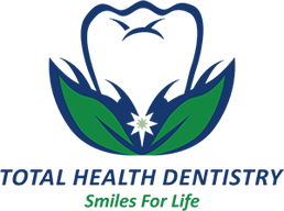 Total Health Dentistry Logo - Green and blue sans-serif type with tooth on bed of leaves on top