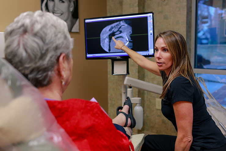Doctor Reviewing Scan With Patient